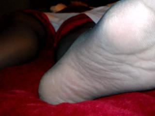Black stocking, red toes - fun to watch if you love feet!