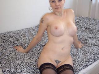 Nice long legs a clean shaved pussy 13 of 18