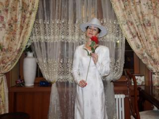 In Wedding Dress and White Hat 5 of 20