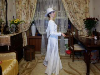 In Wedding Dress and White Hat 12 of 20