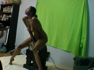 Miko rides on the Sybian stand