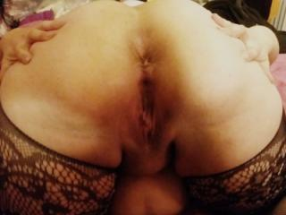 on bed feeling horny