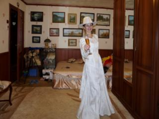 In Wedding Dress and White Hat 20 of 20