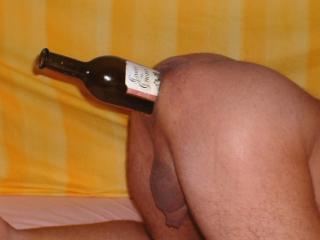 Bottle in ass