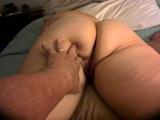 Playing withe her ass!