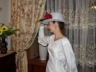 In Wedding Dress and White Hat 15 of 20