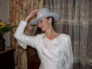 In Wedding Dress and White Hat 16 of 20