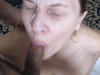 Jerking two cocks and getting a big facial