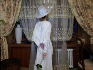 In Wedding Dress and White Hat 9 of 20