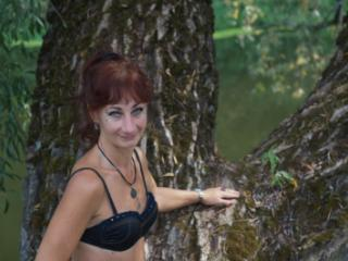 Black bikini near tree upon river