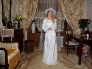 In Wedding Dress and White Hat 3 of 20