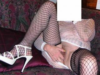 more mature in white with black fishnets