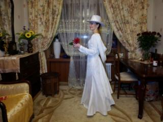 In Wedding Dress and White Hat 10 of 20