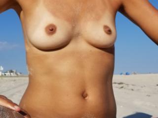 Topless in my Wicked Weasel bottom on a public beach