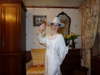 In Wedding Dress and White Hat 18 of 20