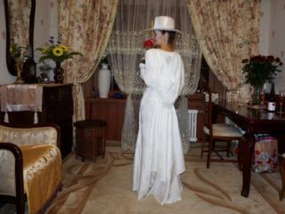 In Wedding Dress and White Hat 4 of 20