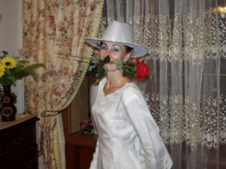 In Wedding Dress and White Hat 17 of 20