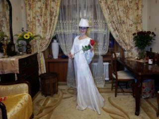 In Wedding Dress and White Hat 11 of 20