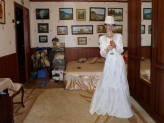 In Wedding Dress and White Hat 19 of 20
