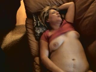 Jill masturbating on the sofa