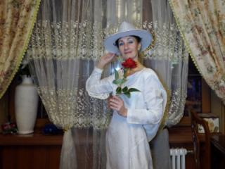 In Wedding Dress and White Hat 6 of 20