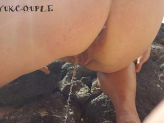 Nude pissing on the beach.