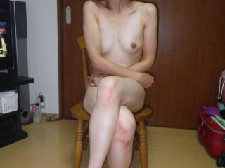 Sayumi posing naked.