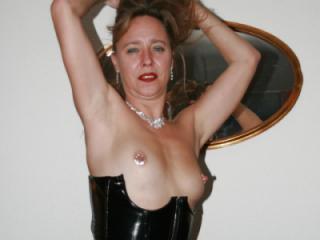 posing in black overkneeboots