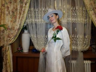 In Wedding Dress and White Hat 14 of 20
