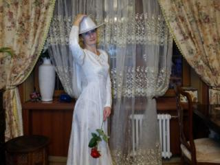 In Wedding Dress and White Hat 7 of 20