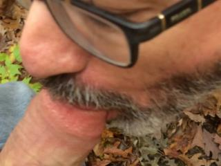 Naked and sucking cock in the woods