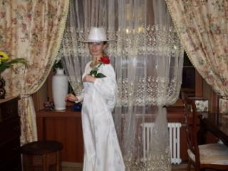 In Wedding Dress and White Hat 1 of 20