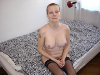 Nice long legs a clean shaved pussy 12 of 18