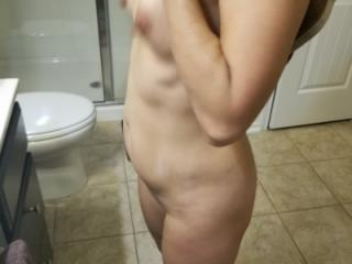 Taking a shower to get ready and wet