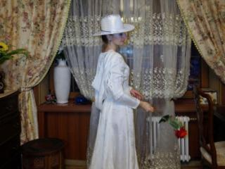 In Wedding Dress and White Hat 8 of 20